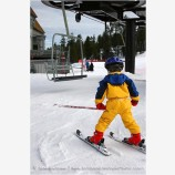 Young Skier Getting On Lift Stock Image,