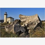 Coquille River Lighthouse and Driftwood Stock Image, Bandon, Oregon