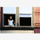 Girl in the Window Stock Image
